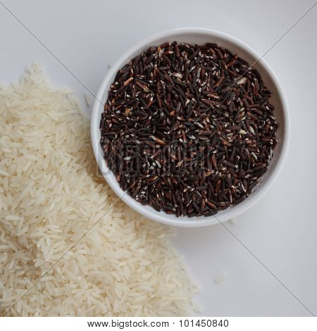Mixture Of Dark Brown And White Rice On Two White Plates