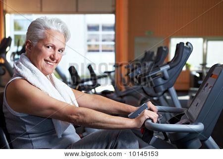 Smiling Senior Woman In Gym