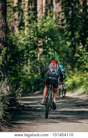 Mountainbiker rides in forest