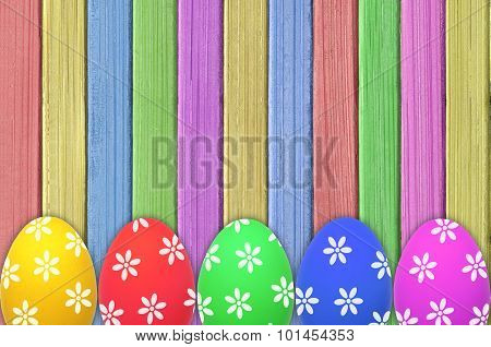 Colorful Easter Eggs On Painted Color Wooden Texture