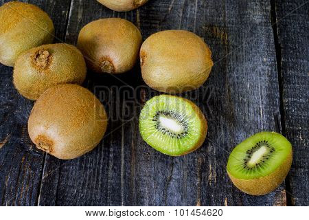 Fresh Kiwi On The Wooden Table, Sliced Kiwi Fruit.