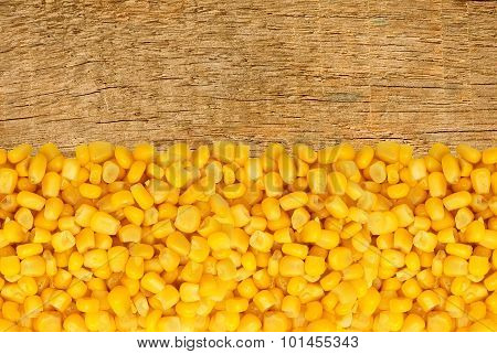 Yellow Corn Grain On Wooden Background