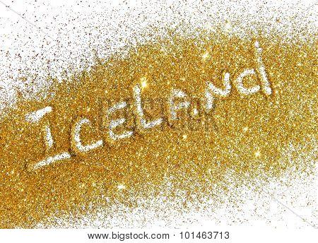 Blurry inscription Iceland on gold glitter sparkle on white background