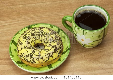 Sweet donuts with coffee. Sweet treat with coffee. Donuts as quick homemade treats
