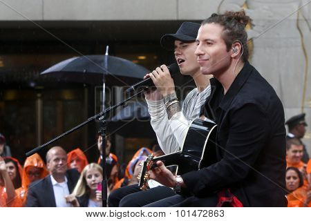 NEW YORK-SEP 10: Singer Justin Bieber (L) performs on NBC's 'TODAY Show' at Rockefeller Plaza on September 10, 2015 in New York City.