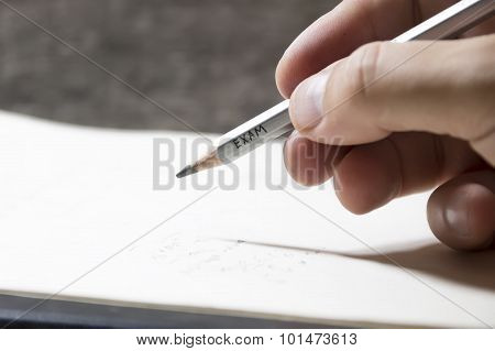 Student Writing A Test, An Inscription On Pencil