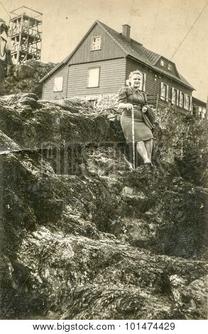 Vintage photo of woman outdoor, 1950's