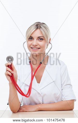 Cheerful young female doctor is serving the patient