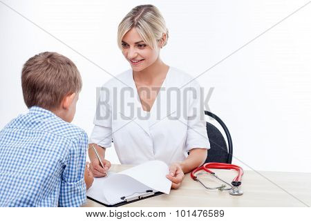 Beautiful young female pediatrician is seeing her patient