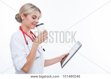 Cheerful young female doctor is resting on break