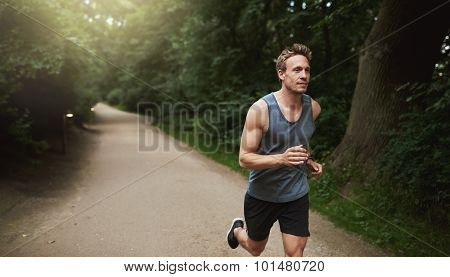 Athletic Man Doing Running Exercise At The Park