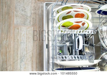 Chores, Clean Dishes And Cutlery In The Dishwasher