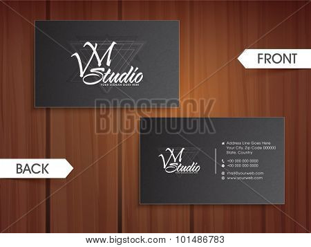 Glossy grey color horizontal business card, name card or visiting card set with front and back view on wooden background.