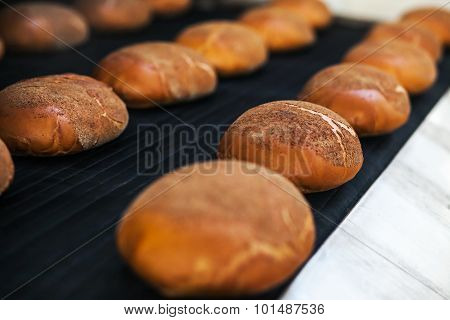 Baked Breads On The Production Line At The Bakery