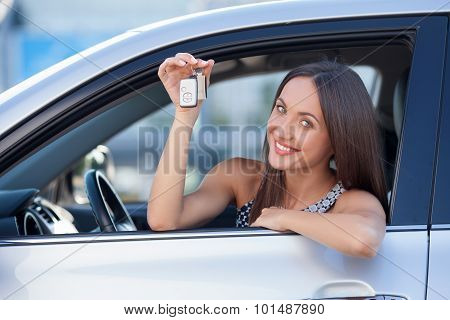 Attractive young businesswoman is presenting her new transport