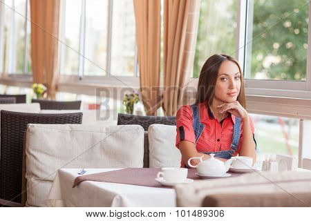 Attractive hipster woman is resting in cafeteria