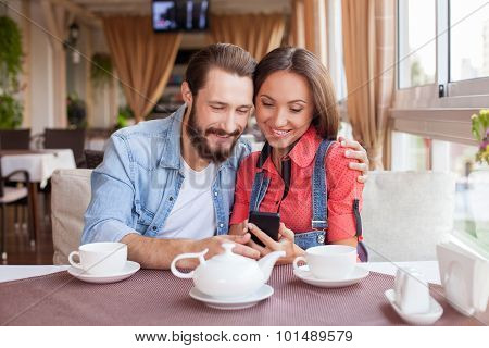 Beautiful loving couple is dating in cafe