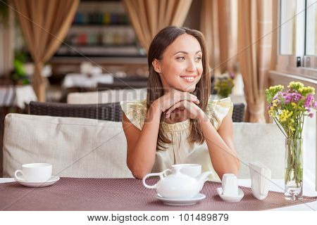 Attractive young girl is resting in cafeteria