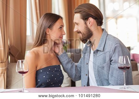 Attractive young loving couple is relaxing in restaurant