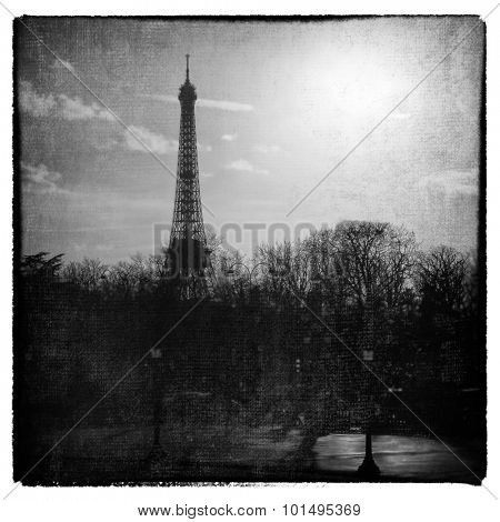 Romantic eiffel tower.  Cross processed  to look like and aged and instant picture with texture
