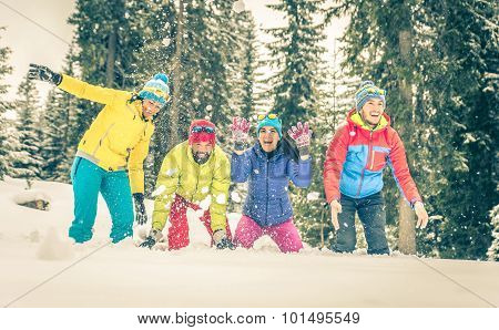 Group Of Friends Playing On The Snow