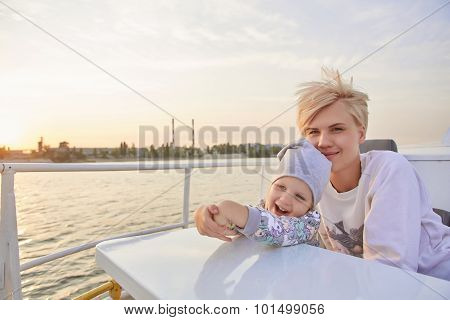 Mother, daughter on yacht or catamaran boat