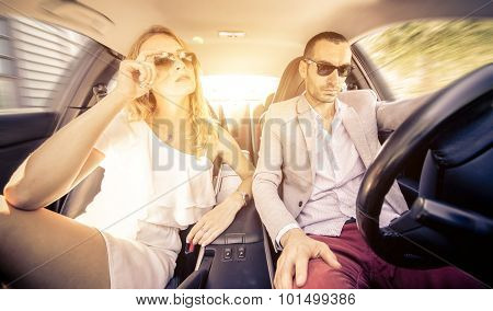 Couple Driving Fast On A Sport Car. Concept About Relationship,transportation And People