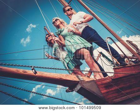 Stylish wealthy friends having fun on a luxury yacht