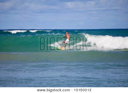 sixty four year old man surfing