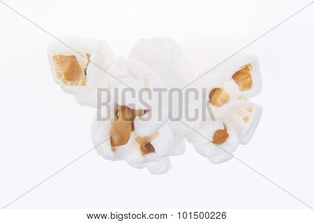 One Popped Kernel Of Popcorn On White
