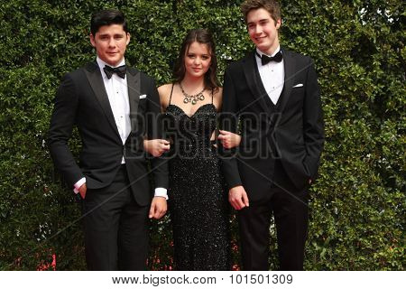 vLOS ANGELES - SEP 12:  Actors Ricardo Hoyos, Ana Golja, Eric Osborne at the Primetime Creative Emmy Awards Arrivals at the Microsoft Theater on September 12, 2015 in Los Angeles, CA