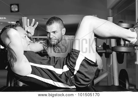 Man Training With Personal Trainer.