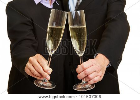 Couple drinking champagne for New Year's Eve with two glasses
