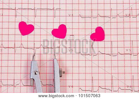 Hearts Of Paper And Calipers On Electrocardiogram Graph, Medicine And Healthcare Concept