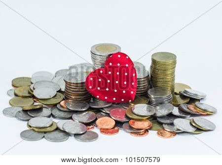 Coin Stack And Red Heart Isolated On White