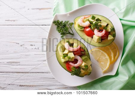 Avocado Filled With Shrimp Salad And Vegetables. Horizontal Top View
