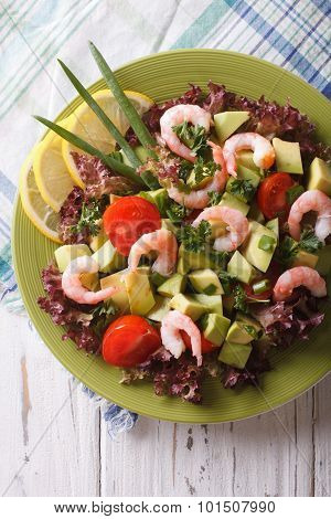 Salad With Avocado, Shrimp And Vegetables Close-up. Vertical Top View