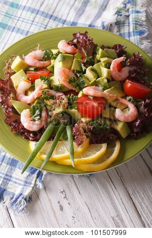 Tasty Avocado Salad With Shrimp And Vegetables Close-up. Vertical
