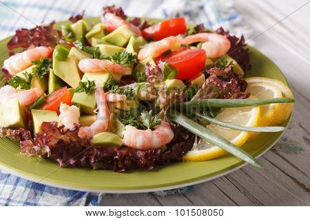 Healthy Foods: Avocado Salad With Shrimp Close-up On A Plate. Horizontal