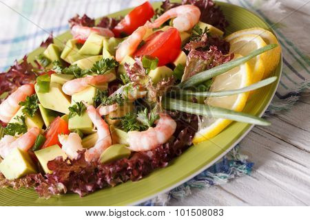 Avocado Salad With Shrimp Close-up On A Plate. Horizontal