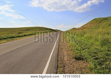 Road among farm fields.