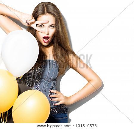 Beautiful fashion model girl with colorful balloons posing isolated on white background. Beauty girl showing peace v-sign or victory gesture. Model with perfect make-up posing in studio with balloons