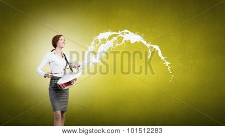 Young businesswoman on color background playing drum