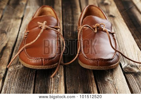 Fashion Brown Shoes On A Brown Wooden Table