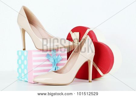 Pair Of Beige Women's High-heeled Shoes With Gift Box On A White Background