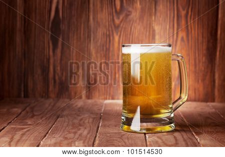 Lager beer mug on wooden table. View with copy space