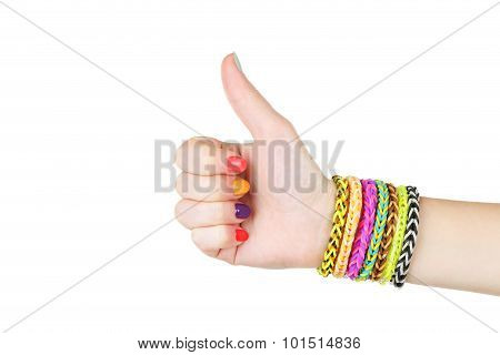 Loom Bracelets On Hand Of Young Girl, Showing Thumbs Up