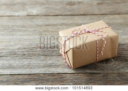Beautiful Gift Box On Grey Wooden Background