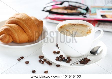 Delicious Croissants With Cup Of Coffee On White Wooden Background