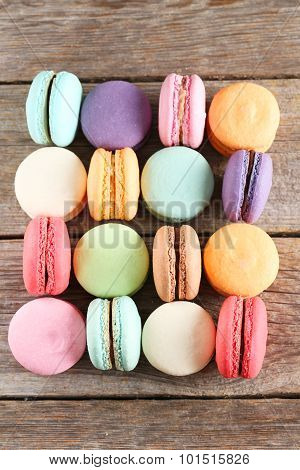 French Colorful And Tasty Macarons On Grey Wooden Table